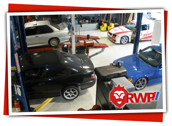Front Half Of RennWerks Shop with BMW E30 and E36 M3 cars