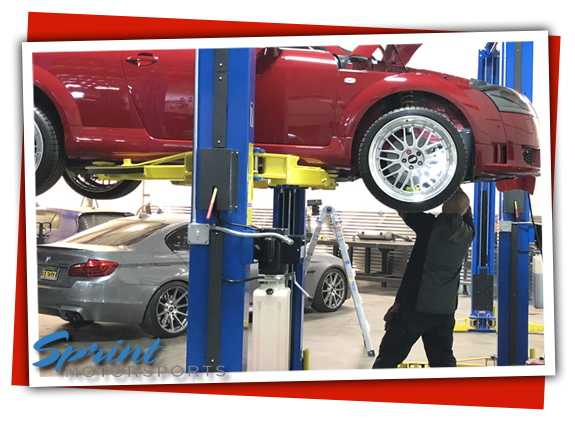 Audi TT getting oil service and BMW 535 waiting for transmission service and brake repair