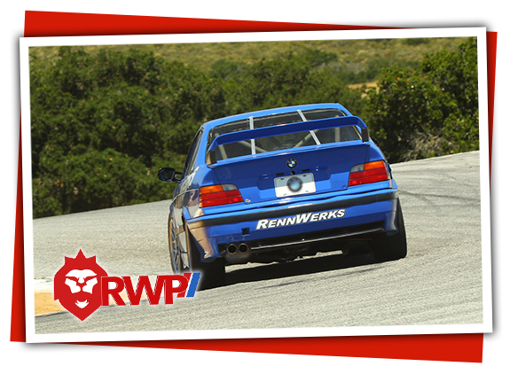 RennWerks BMW E36 M3 Racecar entering Corkscrew at Laguna Seca